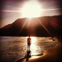 Photo taken at Praia de Guaecá by Lucas L. on 9/8/2012