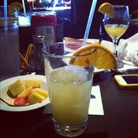 Photo taken at Tavern in the Square by Nicole S. on 12/4/2011