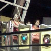 Photo taken at Universal Park by Gabi S. on 12/7/2011