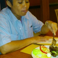 Photo taken at Sizzler by Taw N. on 1/3/2012