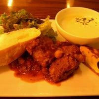 Photo taken at café&books bibliothèque Fukuoka Tenjin by Yuya M. on 8/15/2012