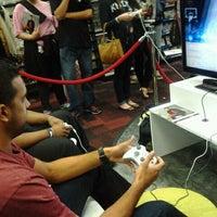 Photo taken at GameStop by Hollis S. on 10/1/2011