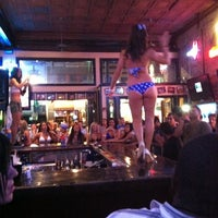 Photo taken at Bikinis Sports Bar & Grill by Johnny H. on 7/18/2011