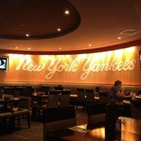 Photo taken at Hard Rock Cafe Yankee Stadium by Ar T. on 7/24/2012