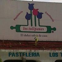 Photo taken at Los Tulipanes by Octavio R. on 8/7/2012