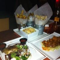 Photo taken at Nosh Kitchen Bar by Colleen C. on 1/19/2012