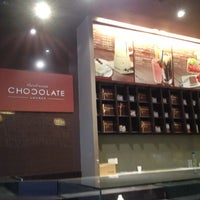 Photo taken at Theobroma Chocolate Lounge by Syd N. on 5/19/2012