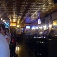 Photo taken at Mulligan's Pub by Matt D. on 8/5/2012