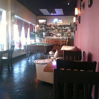 Photo taken at Vinum Coffee & Wine Lounge by Ruby L. on 8/17/2011