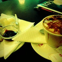 Photo taken at Magnus Coffee by Tiago R. on 1/18/2012