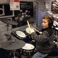 Photo taken at Guitar Center by Dangergirl on 2/11/2012