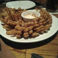 Photo taken at Outback Steakhouse by Kimber F. on 9/4/2011