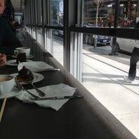 Photo taken at Giovane Café + Market + Eatery by Yigit D. on 3/25/2012