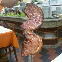 Photo taken at Churrascaria Bandeirantes by Adriano M. on 2/22/2012