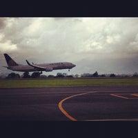 Photo taken at Gate 5 Aeropuerto Internacional Juan Santamaria by Ed V. on 4/22/2012
