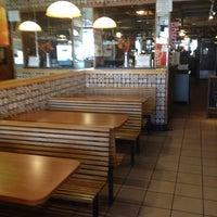 Photo taken at John's Pizzeria & Restaurant by Rino S. on 3/11/2012