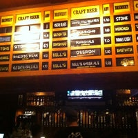 Photo taken at The Lodge Beer and Growler Bar by Suzanne M. on 9/26/2011