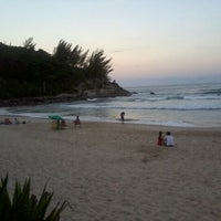 Photo taken at Praia da Ferrugem by João Pedro B. on 2/12/2012