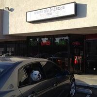 Photo taken at Martini's Pizzeria by Taneshia C. on 4/15/2012