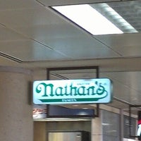 Photo taken at Nathan's Famous by Adam L. on 8/14/2012