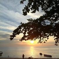 Photo taken at Pantai Teluk Kemang by Yoke Shan L. on 3/13/2011