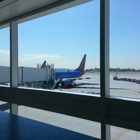 Photo taken at Gate 404 by Paul A. on 8/29/2012