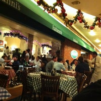 Photo taken at Italianni's Pizza, Pasta & Vino by Irma R. on 12/27/2011
