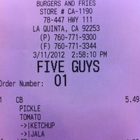 Photo taken at Five Guys by Shannon W. on 3/11/2012