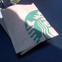 Photo taken at Starbucks by Kate T. on 7/5/2012