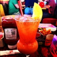 Photo taken at Red Robin Gourmet Burgers by Chelsea G. on 4/21/2012