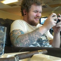 Photo taken at Tampa Humidor by Annie T. on 2/25/2012