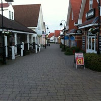 Photo taken at Freeport Designer Outlet Village by Simon L. on 6/26/2012