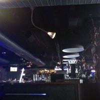 Photo taken at Underdoggs Sports Bar & Grill by Aashish C. on 3/7/2012