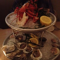 Photo taken at Mermaid Oyster Bar by Rebecca C. on 7/4/2012