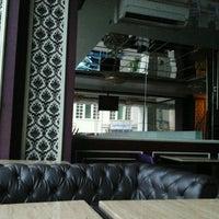 Photo taken at R! Lounge by Teman S. on 11/19/2011