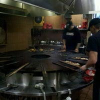 Photo taken at Genghis Grill by Robbie B. on 10/23/2011
