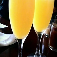 Photo taken at Mill City Café by Nathan K. on 4/22/2012