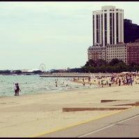 Photo taken at Oak Street Beach by Kirk T. on 7/29/2012