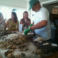 Photo taken at Matunuck Oyster Bar by Lisa G. on 9/10/2011