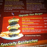 Photo taken at Blazing Onion Burger Company by Robert B. on 1/4/2012
