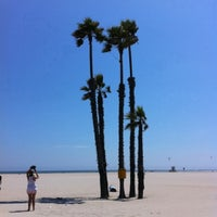 Photo taken at Seal Beach by Justin V. on 8/1/2011