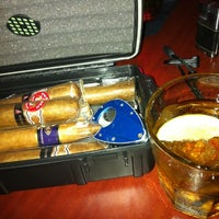 Photo taken at LIT Premium Cigar Lounge by Dennis P. on 6/22/2012
