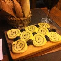 Photo taken at Di Vino Vinoteca Cafe Bar by Kristina K. on 4/7/2012