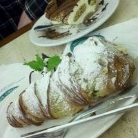 Photo taken at Ferrara Bakery & Cafe by Heather J. on 3/13/2011