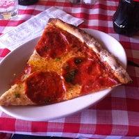 Photo taken at Nice Pizza by Caroline J. on 2/23/2012