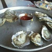Photo taken at Mahi Mah's Seafood Restaurant by Tara R. on 5/28/2012