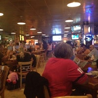 Photo taken at Hooters by Carlos V. on 8/20/2012