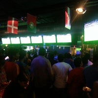 Photo taken at Underdoggs Sports Bar & Grill by Adish K. on 7/1/2012