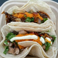Photo taken at Kung Fu Tacos by Josh L. on 7/27/2012