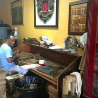 Photo taken at Lianos Dos Palmas Cigars by Maria V. on 8/5/2012